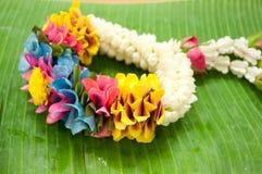 Thai garland colorful flower. On banana leaf Stock Photo