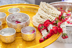 Thai garland Flowers. And Water with jasmine and roses corolla in bowl on golden tray (Use for Songkran festival in Thailand Royalty Free Stock Image