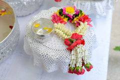 Thai garland Flowers and Water with jasmine and roses corolla in bowl on golden tray Royalty Free Stock Images