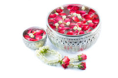 Thai garland Flowers and Water with jasmine and roses corolla in. Bowl isolated on white background (Use for Songkran festival in Thailand royalty free stock photo
