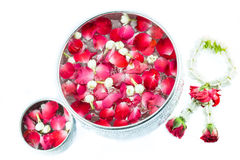 Thai garland Flowers and Water with jasmine and roses corolla in. Bowl isolated on white background (Use for Songkran festival in Thailand stock photos