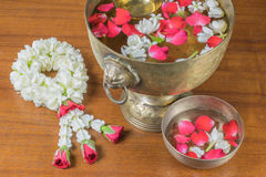 Thai garland Flowers and Water with jasmine and roses corolla in Stock Photo