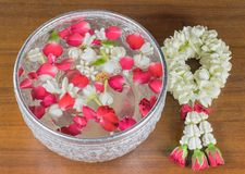 Thai garland Flowers and Water with jasmine and roses corolla in Royalty Free Stock Photo
