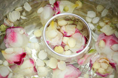 Thai garland Flowers and Water Royalty Free Stock Photography
