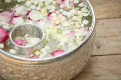 Thai garland Flowers and Water Royalty Free Stock Photos