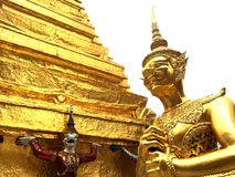 Thai giant. A graceful giant in gold color at Thai temple Stock Photography
