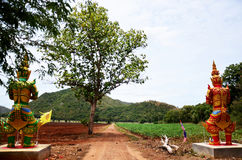 Thai Giant Guardian at Soil road of countryside Royalty Free Stock Photo