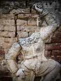 Thai giant. No head Thai giant stucco on old brick wall Stock Photography