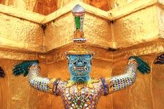 Thai giant stand around gold pagoda Stock Photos