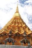 Thai giant stand around gold pagoda Royalty Free Stock Photos