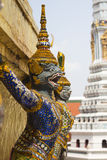 Thai Giant Statue. At the base of pagoda Royalty Free Stock Photo