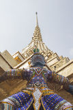 Thai Giant Statue. At the base of pagoda Stock Photo