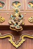Thai giant Wood Carving on teak chapel Stock Image
