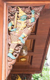 Thai giant Wood Carving on teak chapel Stock Photography