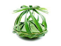 Thai Gift. Thai dessert wrap with banana leaves in Coconut Leaf basket royalty free stock photography