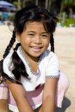 Thai girl on beach. Portrait on a little Thai girl on the beach stock photography