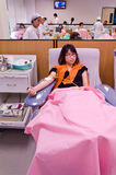 Thai girl donating blood in red cross institution Royalty Free Stock Photography
