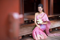 Thai girl dresses Thai traditional costume at traditional Thai Royalty Free Stock Image