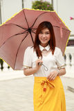 Thai girl dressing and umbrella with traditional style (palace b Stock Image