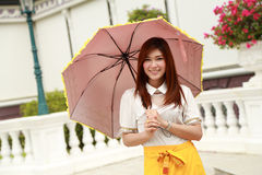 Thai girl dressing and umbrella with traditional style (palace b Stock Photography
