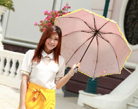 Thai girl dressing and umbrella with traditional style   Stock Photo