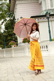 Thai girl dressing and umbrella with traditional style Stock Photos