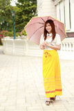 Thai girl dressing and umbrella with traditional style Royalty Free Stock Image