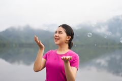 Thai girl enjoy her lifestlye and happy with air bubbles Royalty Free Stock Photo
