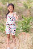 Thai girl in Grass flower field Royalty Free Stock Photography