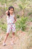 Thai girl in Grass flower field Stock Image
