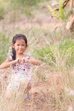 Thai girl in Grass flower field Royalty Free Stock Images