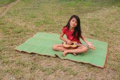 Thai girl learned to play ukulele Stock Photos
