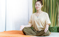 Thai girl is meditating before taking spa course. Young Thai girl is meditating before taking spa course Stock Images