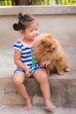 thai girl with pomeranian Royalty Free Stock Photo