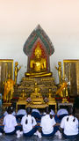 Thai girl respect old Buddha statue Stock Photos