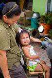Thai girl sitting on chair fitted to the motor bike Stock Image