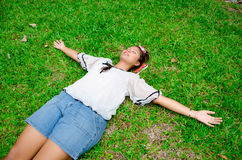 Thai girl sleep on the ground freely Stock Photography