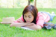 Thai girl sleeping on grass Stock Image