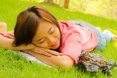 Thai girl sleeping on grass in park Royalty Free Stock Photography