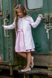 Thai girl staring down. Little tai girl on an old train staring down Royalty Free Stock Image