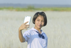 Thai girl student taking selfie  at the white meadows Stock Photography