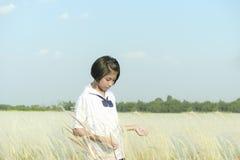 Thai girl students at prairie white. Royalty Free Stock Photography