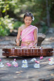 Thai girl in Thai dress playing Thai music Royalty Free Stock Image