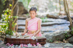 Thai girl in Thai dress playing Thai music Stock Image