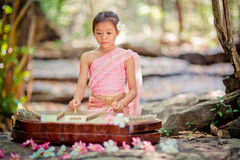 Thai girl in Thai dress playing Thai music Stock Photo