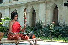 Thai girl in traditional dress in playing Thai fiddle. Stock Images