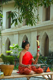 Thai girl in traditional dress in playing Thai fiddle. Royalty Free Stock Images