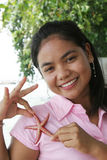 Thai Girl With Starfish Stock Photo