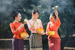 Thai girls and laos girls splashing water during Songkran festival. Water blessing ceremony of adults,Buddha statue water ceremony in songkran festival,Thailand Stock Photography