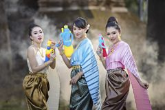 Songkran festival. Thai girls and laos girls splashing water during Songkran festival,Water blessing ceremony of adults,Buddha statue water ceremony in songkran Royalty Free Stock Photo